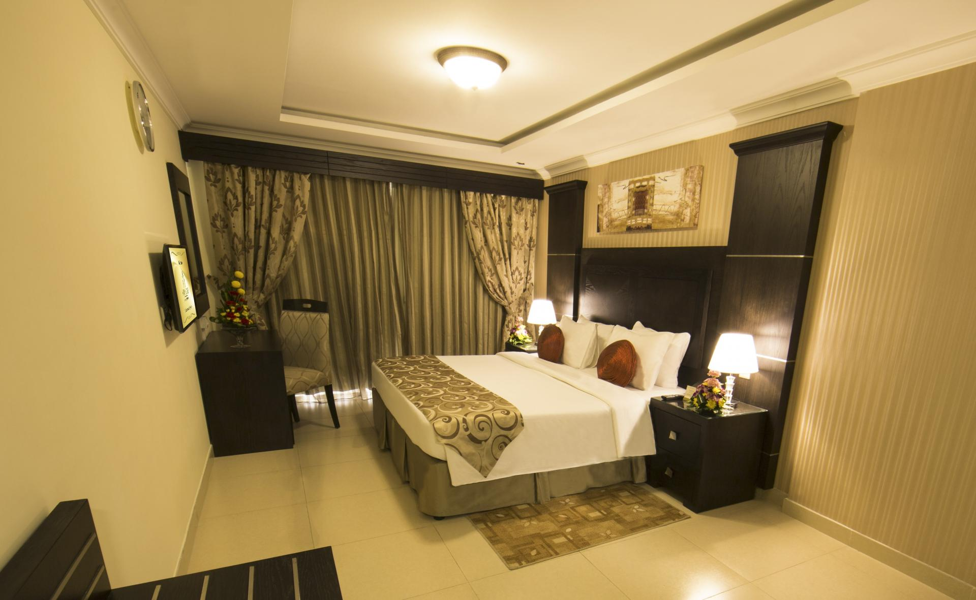 Bedroom at Ivory Grand Hotel Apartments - Citybase Apartments