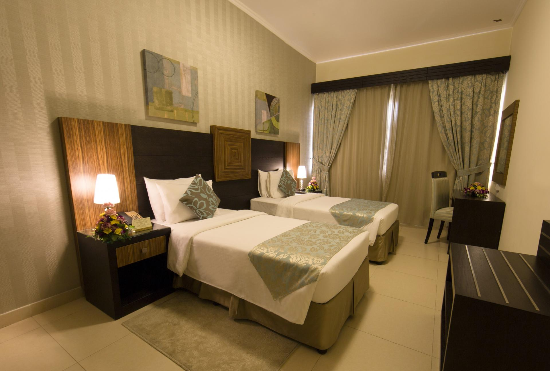 Twin room at Ivory Grand Hotel Apartments - Citybase Apartments