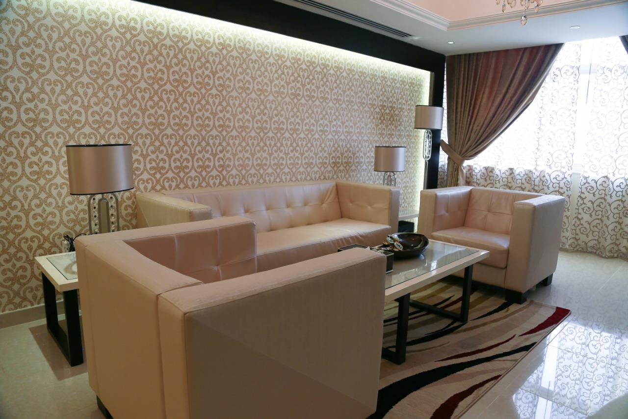 Sofa at Ivory Grand Hotel Apartments - Citybase Apartments