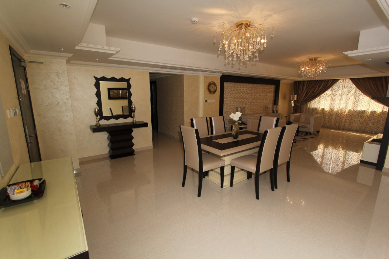 Spacious dining room at Ivory Grand Hotel Apartments - Citybase Apartments