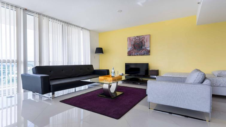 Living area at Dharma Home Suites Brickell - Citybase Apartments