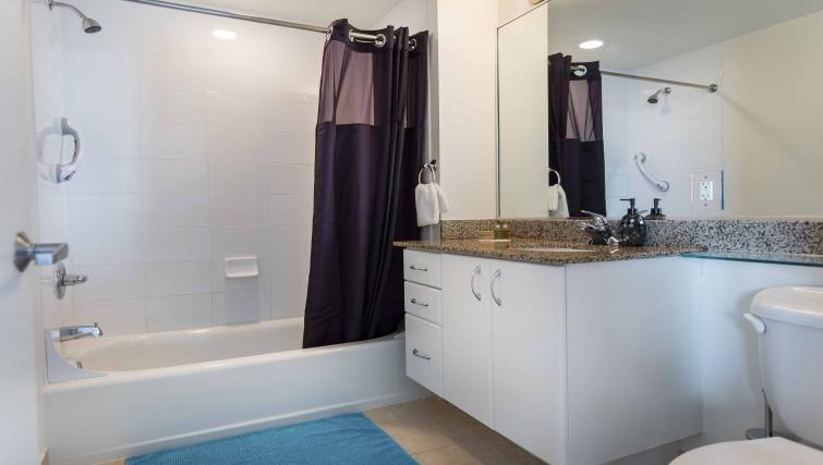 Shower at Dharma Home Suites Brickell - Citybase Apartments