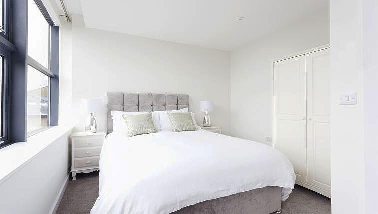 Bright bedroom at City Stay Apartments Centro - Citybase Apartments