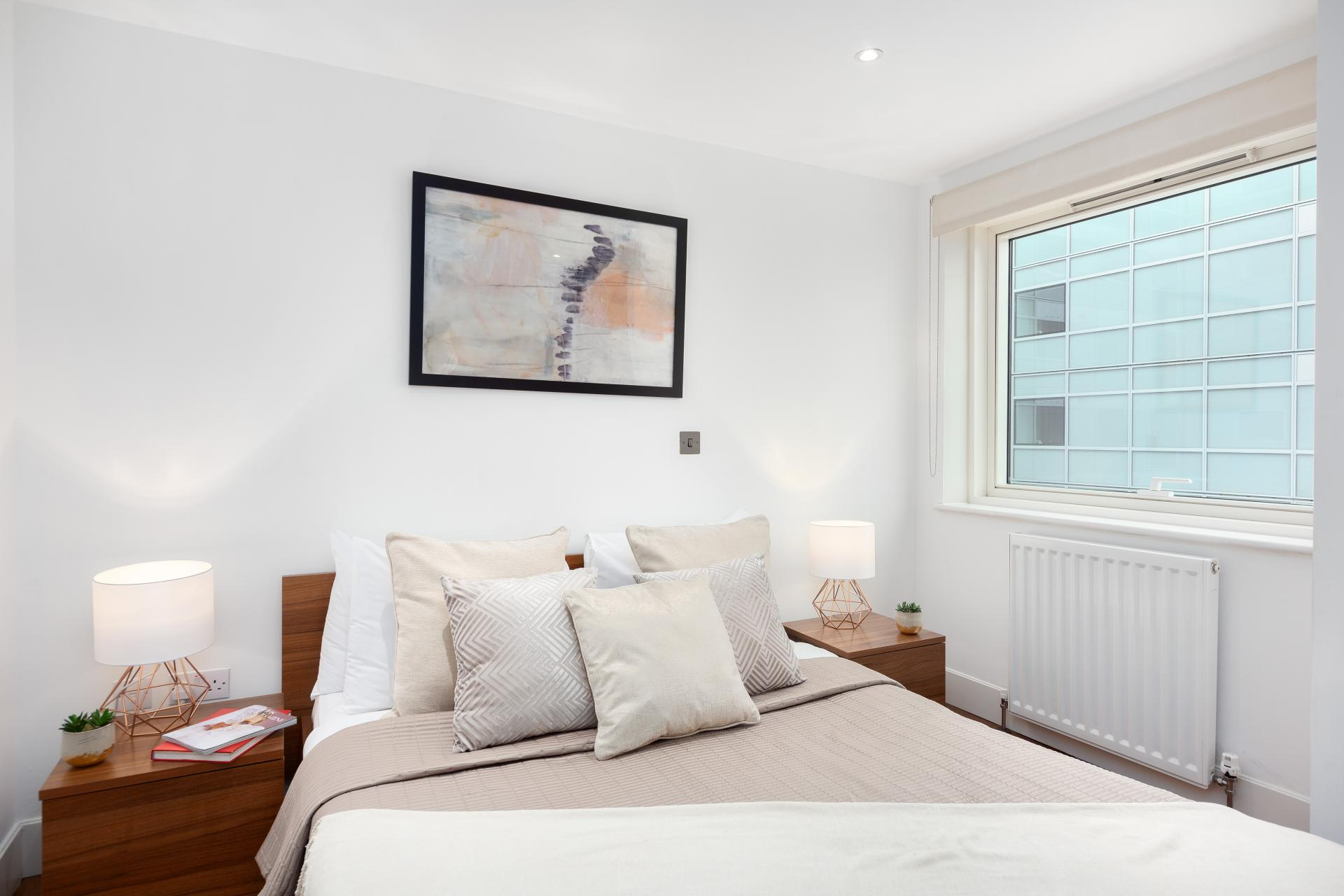 Cosy bedroom at One Commercial Street - Citybase Apartments