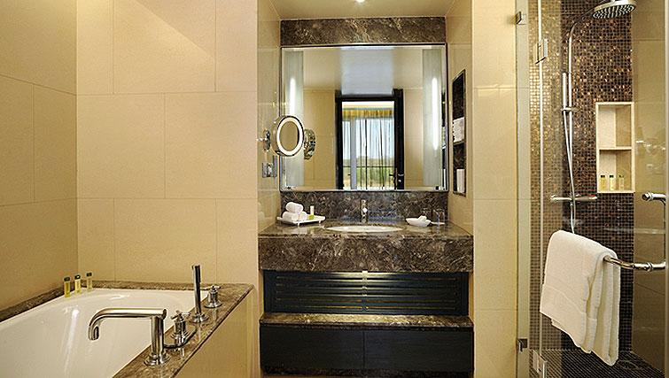 Bathroom at DoubleTree Suites by Hilton Bangalore - Citybase Apartments