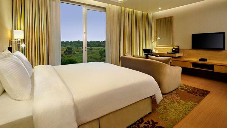 Double bedroom at DoubleTree Suites by Hilton Bangalore - Citybase Apartments
