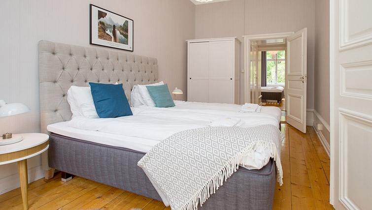 Bed at Krona Apartment - Citybase Apartments
