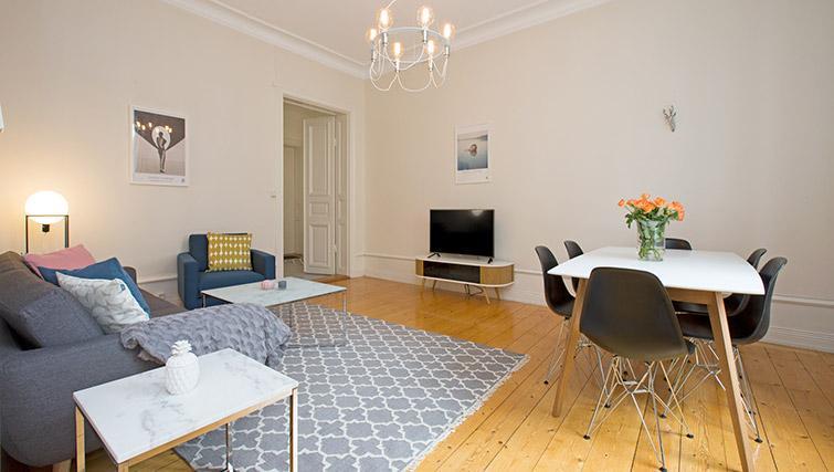 Living area at Krona Apartment - Citybase Apartments