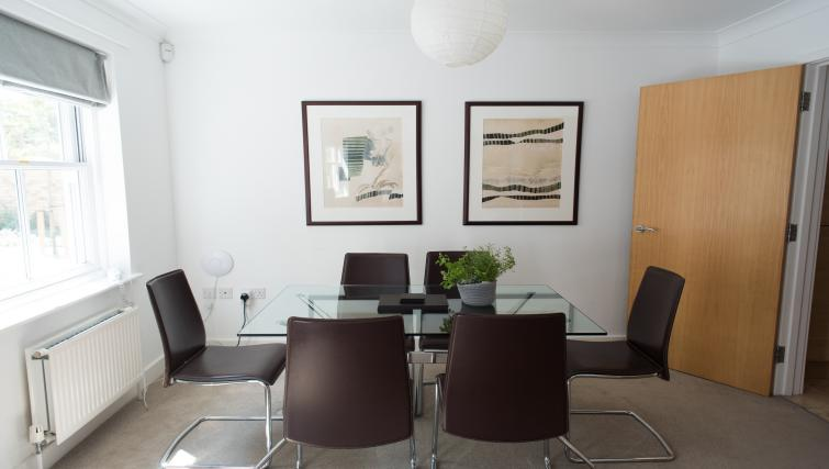 Dining table and chairs at Nelson Court Apartments - Citybase Apartments
