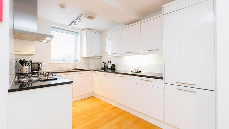 Kitchen area at Kew Bridge Court Furnished Apartments - Citybase Apartments