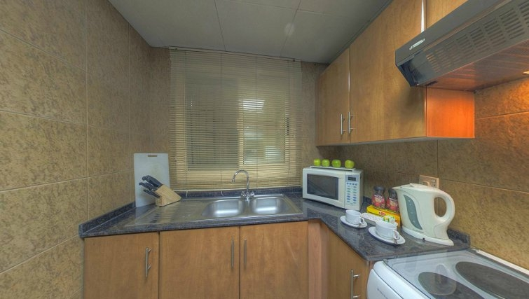 kitchen at Al Barsha Aparthotel - Citybase Apartments