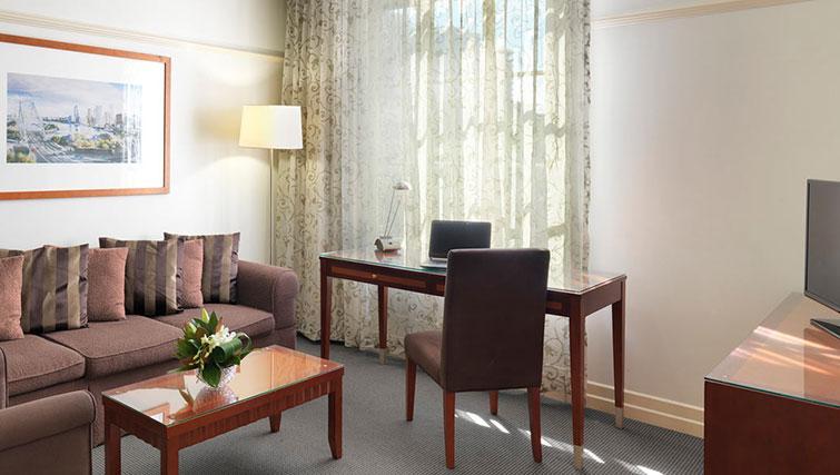 Living room at Adina Apartment Hotel Brisbane Anzac Square - Citybase Apartments