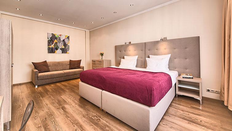 Bedroom at Konvikt Apartment - Citybase Apartments