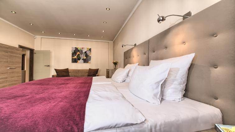 Bed at Konvikt Apartment - Citybase Apartments