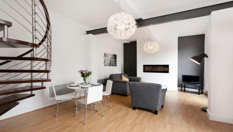 Dining area at Coach House Apartment - Citybase Apartments