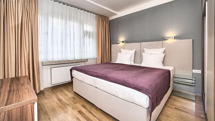 Master bedroom at Art Residence Krocinova - Citybase Apartments