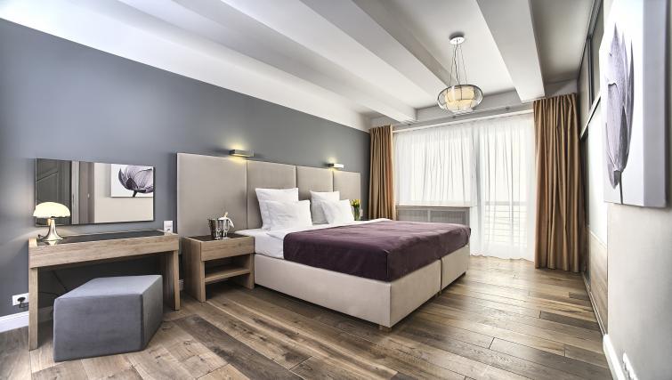 Stylish bedroom at Art Residence Krocinova - Citybase Apartments
