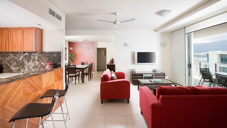 Open-plan living area in 3 bed apartment at Mantra Trilogy - Citybase Apartments