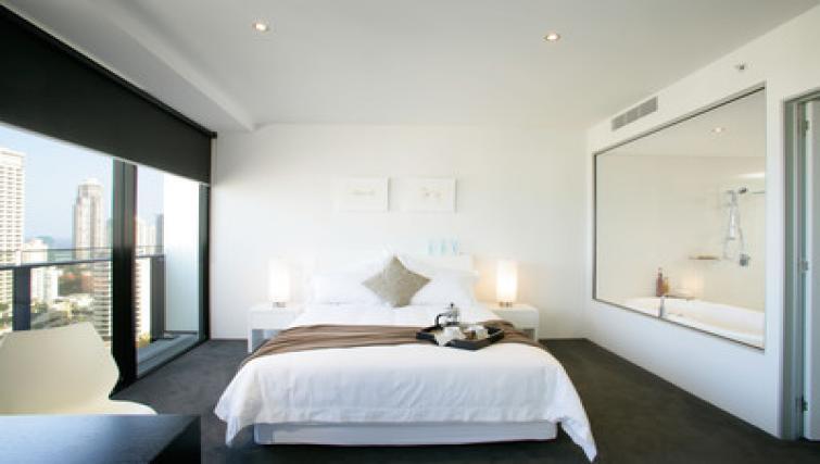 Bed at Mantra Circle on Cavil - Citybase Apartments
