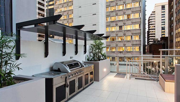 BBQ area at Mantra Midtown Brisbane Apartments - Citybase Apartments