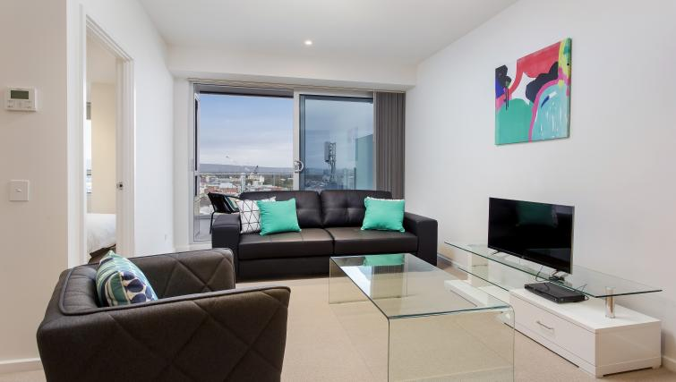 Living room at Astra Apartments Adelaide Vision - Citybase Apartments