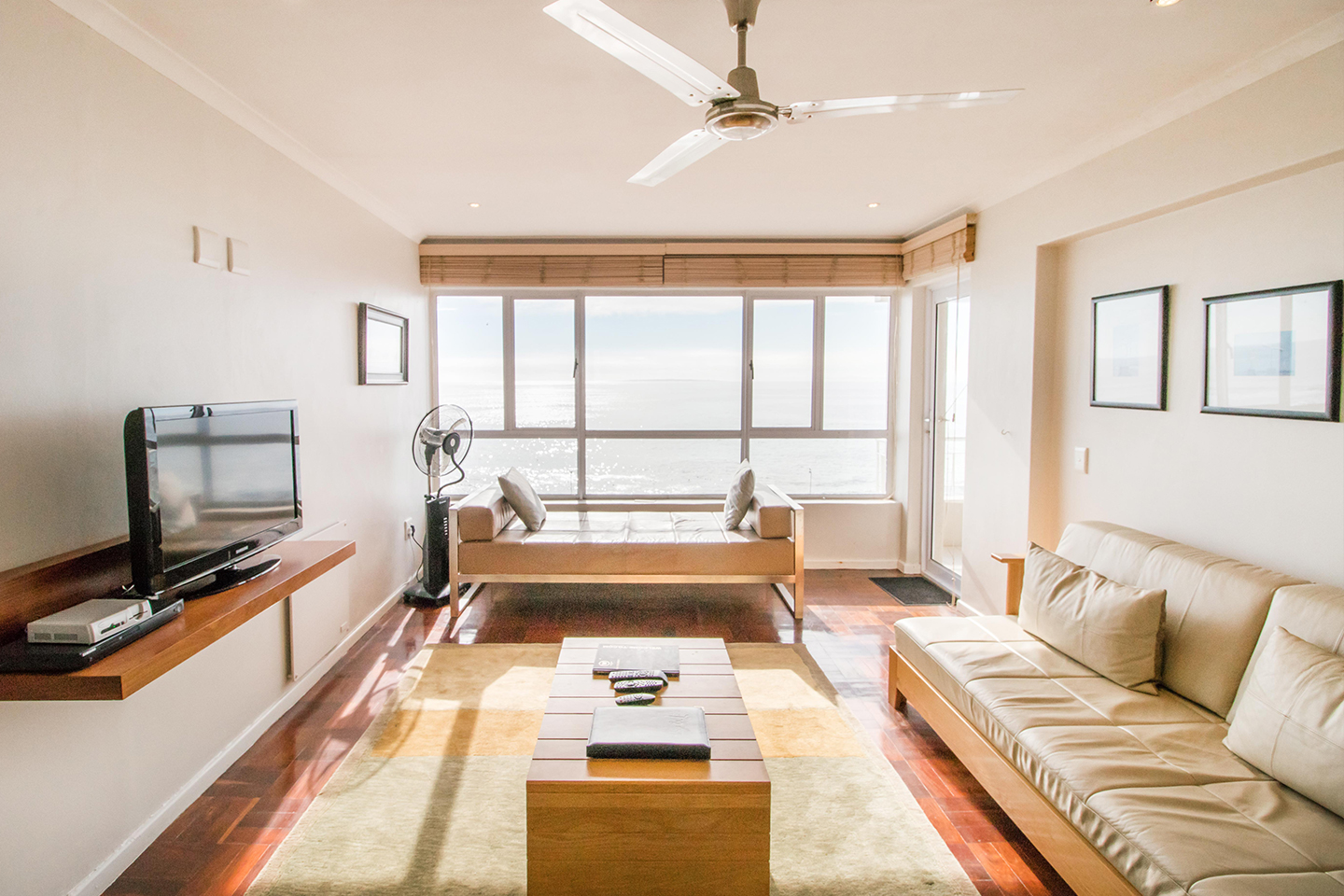 Living room at Mouille Point Village - Citybase Apartments