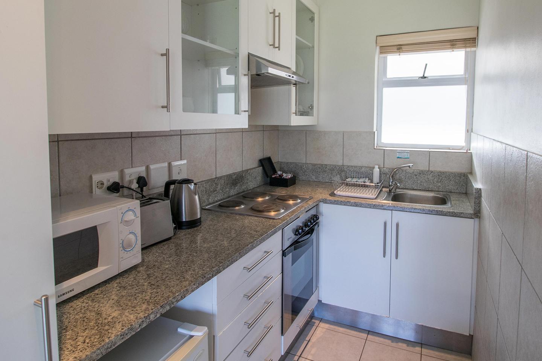 Kitchen area at Mouille Point Village - Citybase Apartments