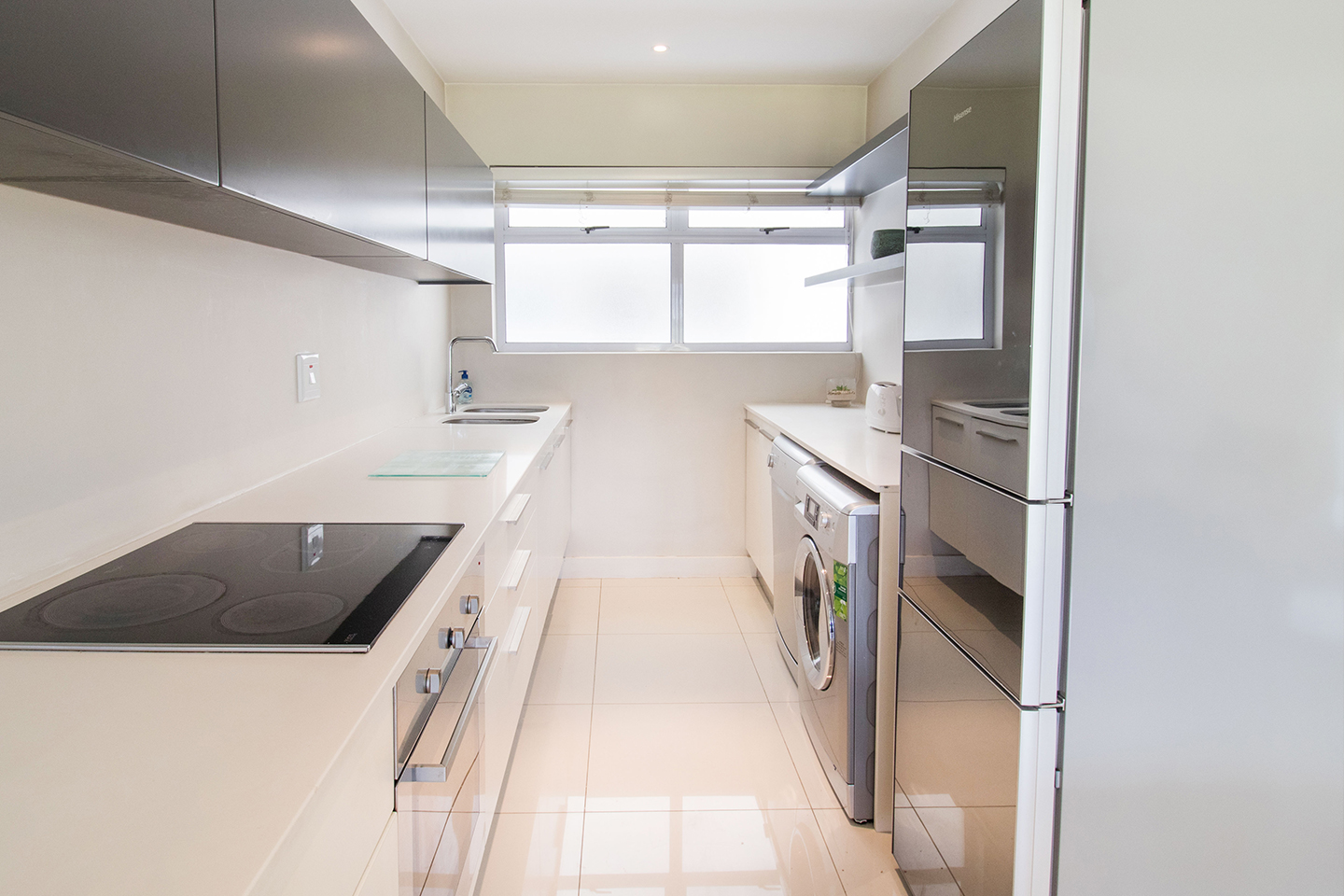 2 bed kitchen at Mouille Point Village - Citybase Apartments
