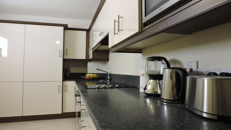 Kitchen space at Five Lamps Suites - Citybase Apartments