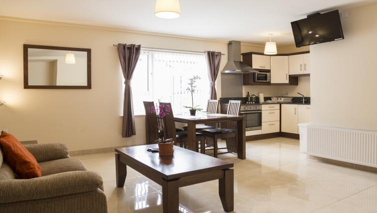 Spacious living area at Five Lamps Suites - Citybase Apartments