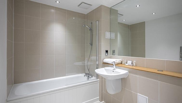 Full bathroom at Native Waterloo Apartments - Citybase Apartments