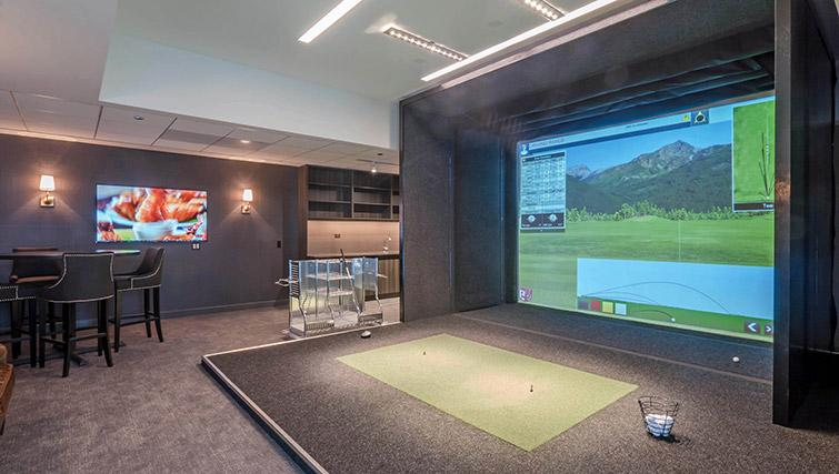 Golf simulator at Wolf Point West Apartments - Citybase Apartments
