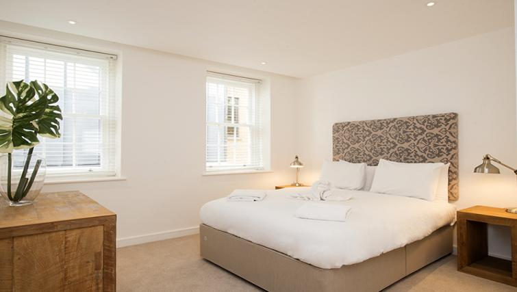 Double bed at Lovat Lane Monument Apartments - Citybase Apartments