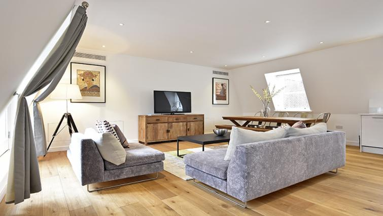 Living room at Lovat Lane Monument Apartments - Citybase Apartments