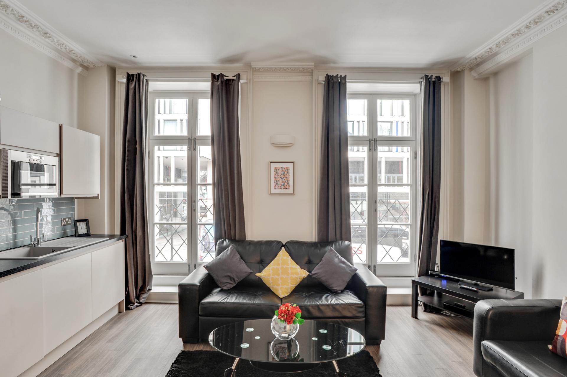 Sofa black at London Victoria Apartments, Victoria, London - Citybase Apartments