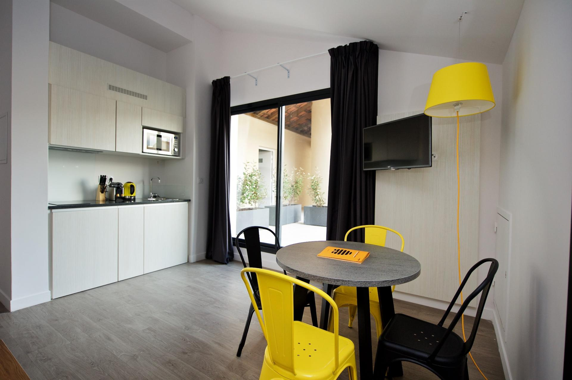 Living space at Staycity Centre Vieux Port - Citybase Apartments