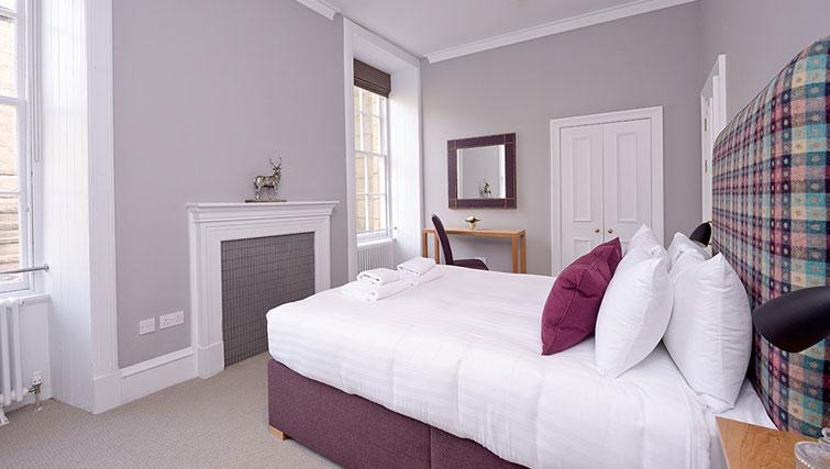Master bedroom at Distillers House - Citybase Apartments