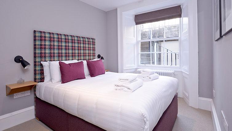 Bright bedroom at Distillers House - Citybase Apartments