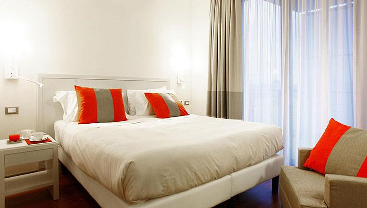 Bedroom at Ramada Plaza Milano - The Residence - Citybase Apartments