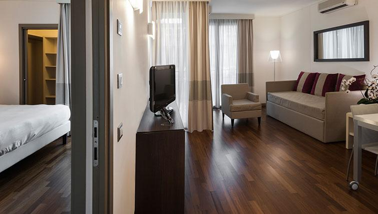 Bedroom/living area at Ramada Plaza Milano - The Residence - Citybase Apartments