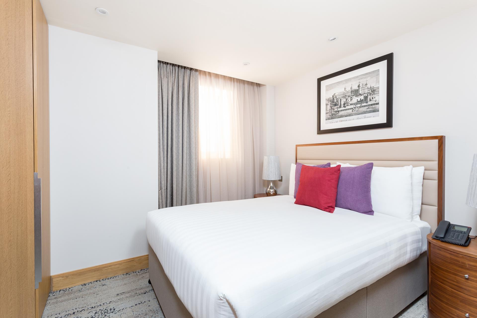 King size bed at Sanctum Belsize Apartments - Citybase Apartments