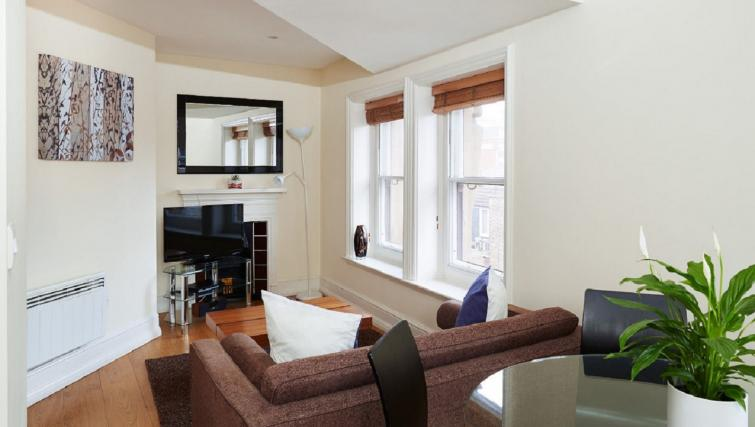 Bright living area at Charing Cross by Q Apartments - Citybase Apartments