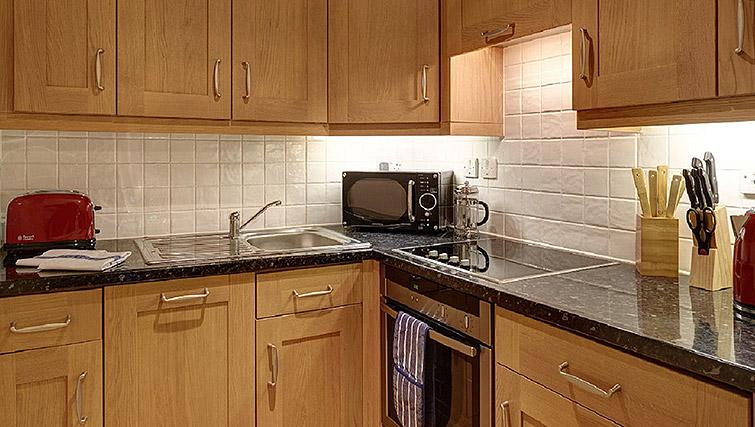 Fully equipped kitchen at Charing Cross by Q Apartments - Citybase Apartments