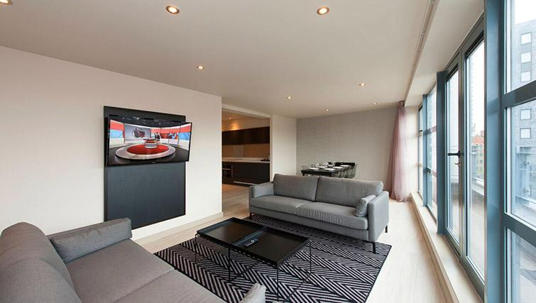 Stylish living area at La Reserve Aparthotel - Citybase Apartments