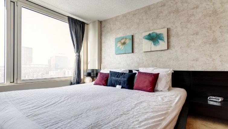 Bedroom at Les etoiles Apartments - Citybase Apartments