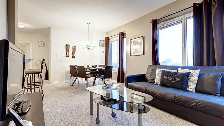 Spacious living room at Laurier East Apartments - Citybase Apartments