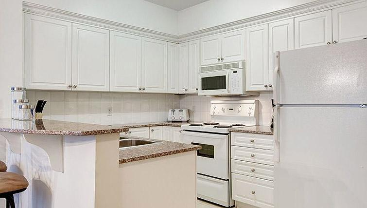Equipped kitchen at Laurier East Apartments - Citybase Apartments