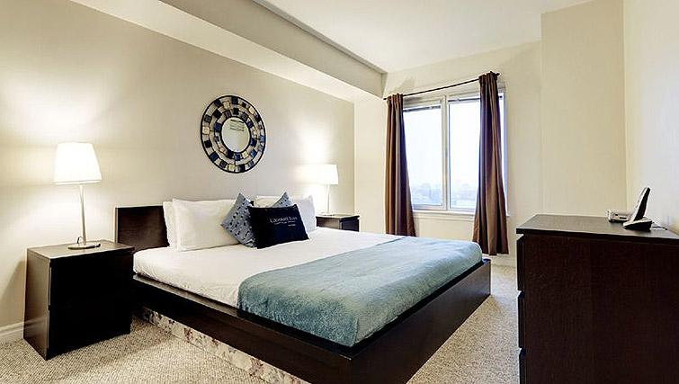 Spacious bedroom at Laurier East Apartments - Citybase Apartments