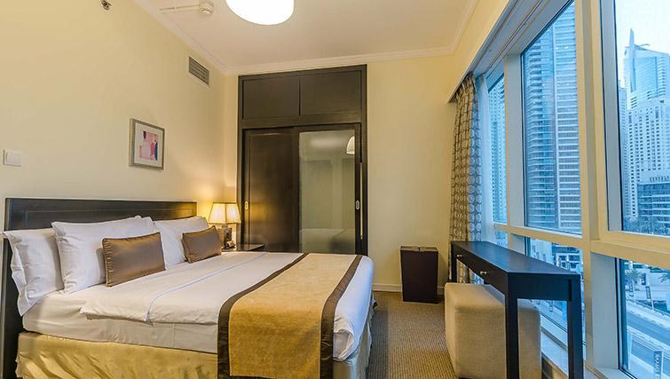 Cosy bedroom at Nuran Marina Serviced Residences - Citybase Apartments
