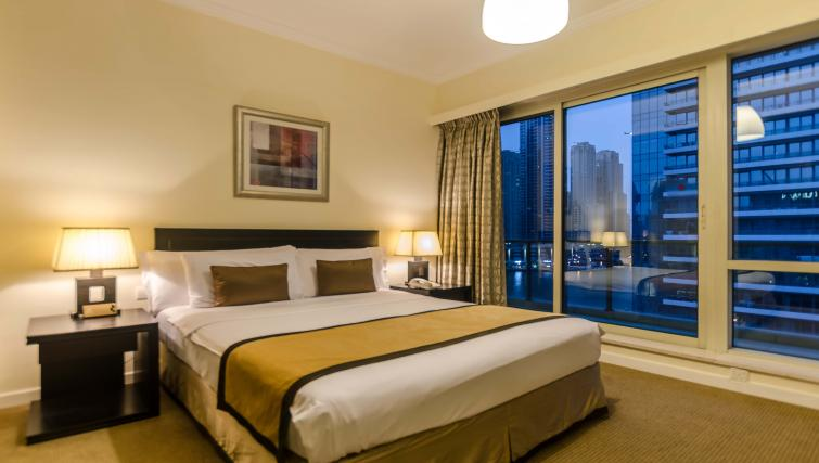 Bed at Nuran Marina Serviced Residences - Citybase Apartments